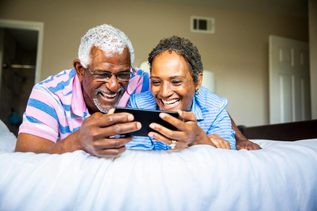 Couple watching show on smartphone