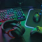 Gamer desktop setup with headphones mouse controller and RGB keyboard and mousepad 1024x716