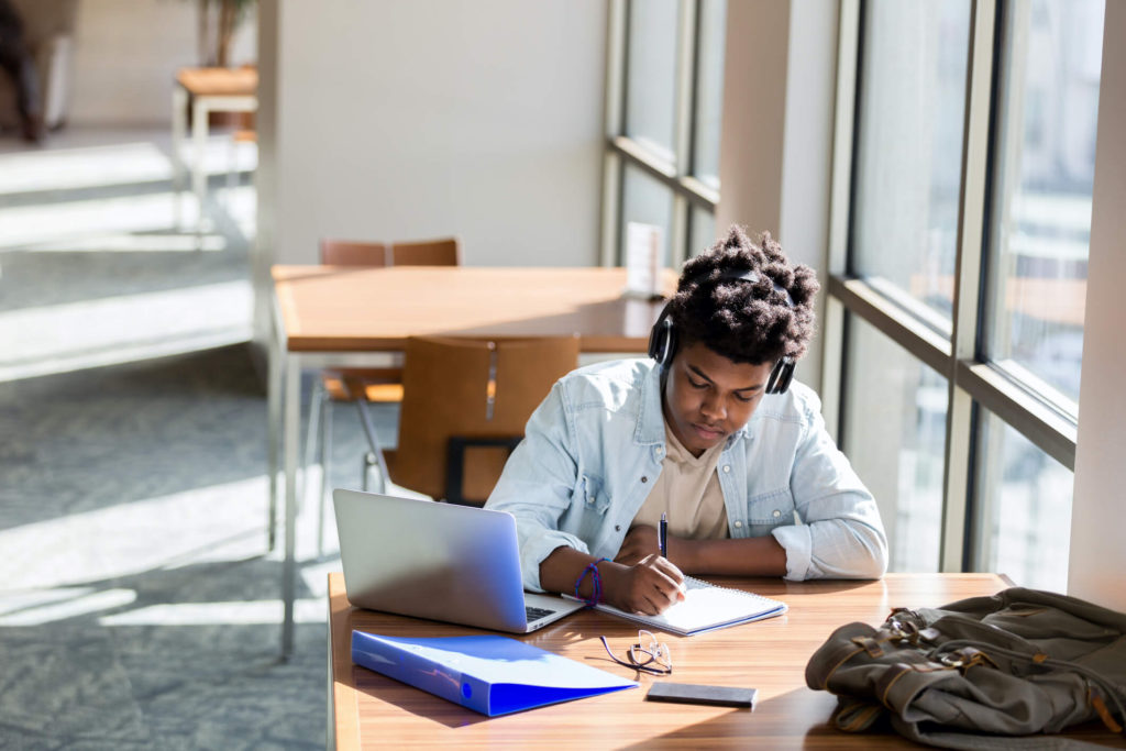 Kid on computer in library