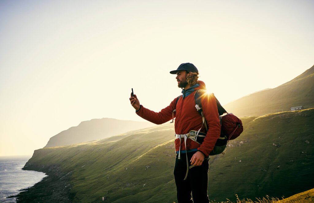 Man Using Phone in the Wilderness