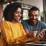 Man and woman online shopping using a VPN 1024x683