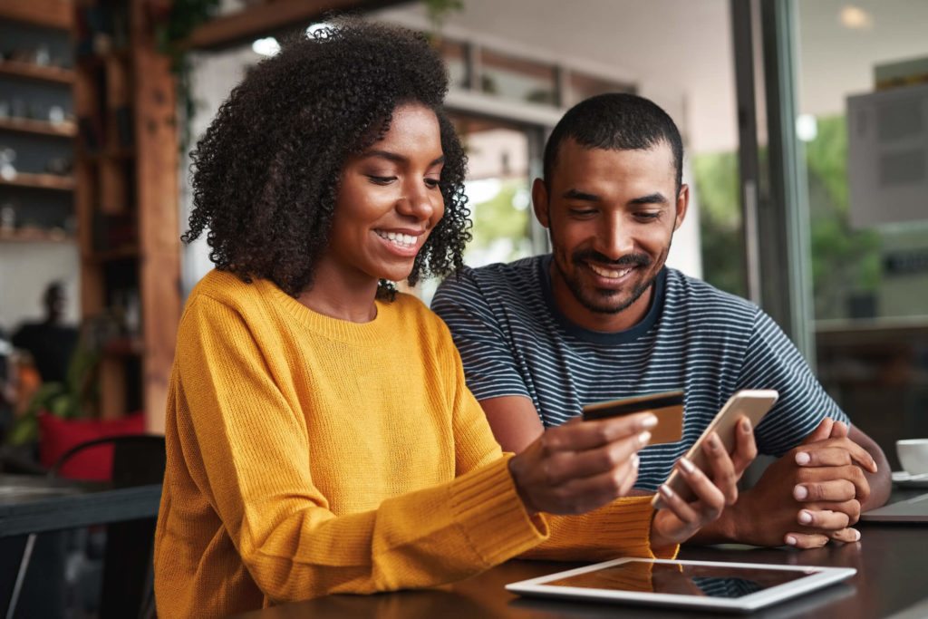 Man and woman online shopping using a VPN