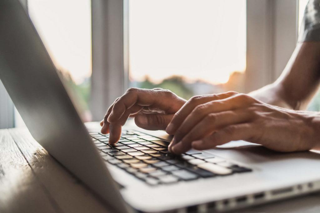 Person on laptop using CyberGhost VPN