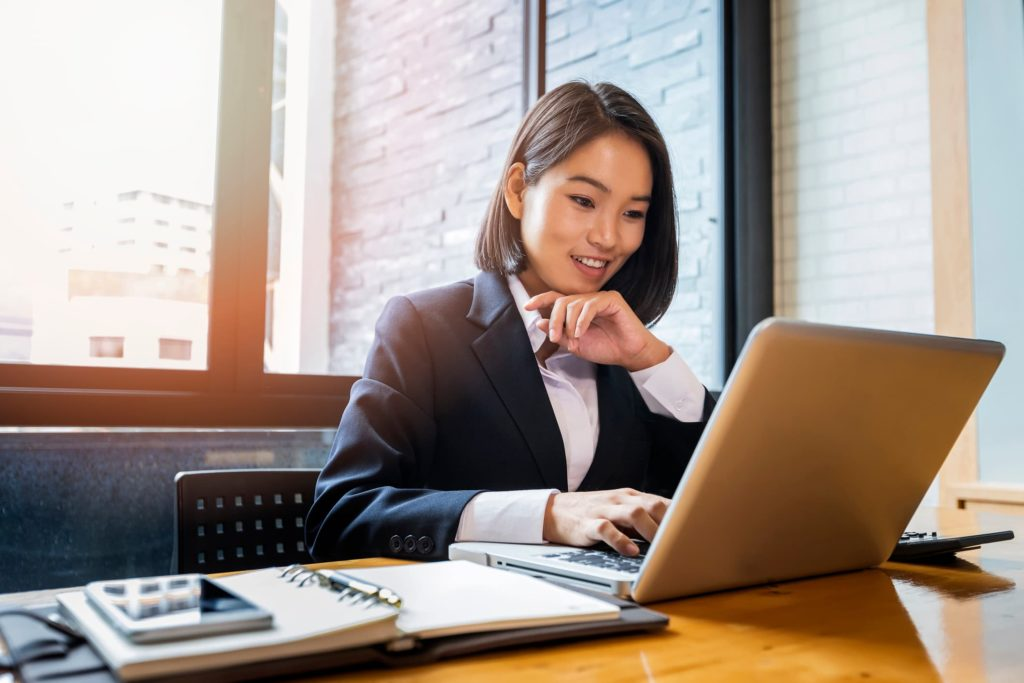 purevpn review woman at computer
